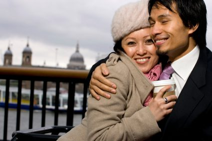 Best places to meet guys in London - Man and women cuddeling with smiles