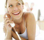 Long Distance Relationship Advice - Girl on phone, lying down on bed
